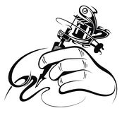 Tattoo artist. Tattoo machine. Black and white design of  hand with manual  tattoo machine Stock Photography