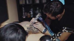 Tattoo artist make tattoo at the studio. HD stock video footage