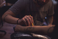Tattoo artist makes scetch Stock Photo