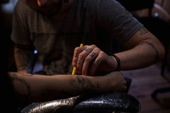 Tattoo artist makes scetch Stock Image