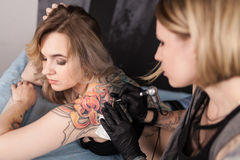 Tattoo artist in a studio Stock Image