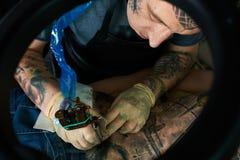 Tattoo artist in studio. Closeup Royalty Free Stock Photography