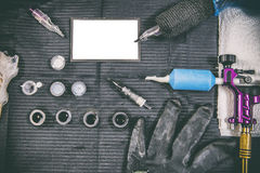 Tattoo artist table with objects and empty business card in the Stock Image
