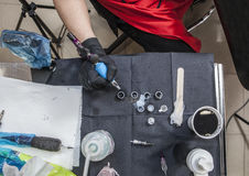 Tattoo artist table while she is refilling the gun. Overhead shot royalty free stock images