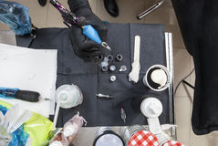 Tattoo artist table while she is refilling the machine Royalty Free Stock Photos