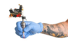 Tattoo artist at work isolated on white. Closeup. Tattoo artist at work isolated on white royalty free stock images