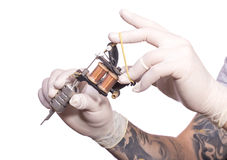 Tattoo artist at work.  Preparing the needle and Stock Photography