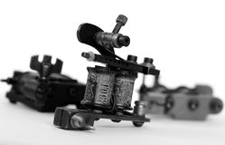 Tattoo machine. A tattoo artist while working in the Studio Stock Images