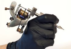 Tattoo machine. A tattoo artist while working in the Studio Royalty Free Stock Photography