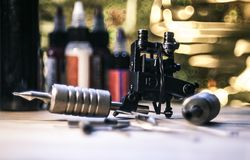 Tattoo machine. A tattoo artist while working in the Studio Stock Image