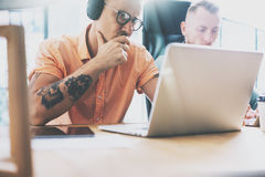 Tattoo Artist Working Wood Table Laptop Modern Interior Design Loft.Coworkers Work Office Studio.Two Hipsters Use. Contemporary Notebook Digital Tablet New stock photo