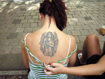 Tattoo as a fashion. Tattoo is growing in popularity in a young people everyday fashion stock photography