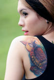 Tattoo asian girl. A tattoo asian girl portrait stock photo