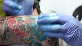 Tattoo being put on arm stock video