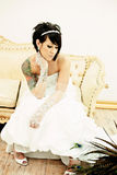 Tattoo Bride on Couch Stock Images