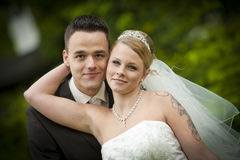 Tattoo bride with groom. After wedding or marriage ceremony the groom is standing with his pretty bride. she is wearing a nice diadem and white dress. it is a royalty free stock image