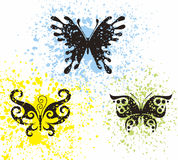 Tattoo butterflies. In multicolor spots Royalty Free Stock Image