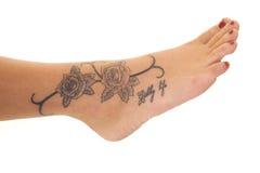 Tattoo close rose foot Stock Photo