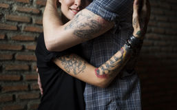 Tattoo Couple Embracing With Passion. Tattoo Couple Embracing each other Stock Images