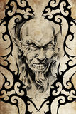 Tattoo devil with piercing Royalty Free Stock Photography