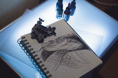 Tattoo equipment and scetch. Tattoo accessories consist of tattoo appliance, ink and scetch Royalty Free Stock Photography