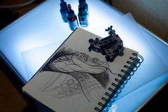 Tattoo equipment and scetch. Tattoo accessories consist of tattoo appliance, ink and scetch Royalty Free Stock Photo