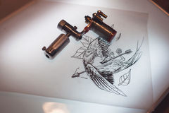Tattoo equipment and scetch. Was prepared for making tattoo in salon Royalty Free Stock Photo