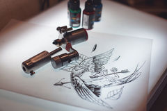 Tattoo equipment and scetch. Was prepared for making tattoo in salon Stock Images