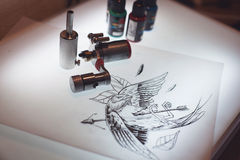 Tattoo equipment and scetch. Was prepared for making tattoo in salon Stock Photography