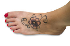 Tattoo on foot Royalty Free Stock Image