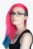 Tattoo girl with colorful hair and glasses Stock Images