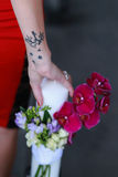Tattoo girl holding a candle with flowers Stock Photography