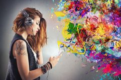 Tattoo girl listens to music Royalty Free Stock Image