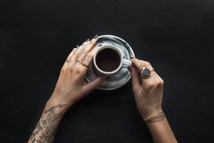 Tattoo Hands with Coffee Cup Beverage Royalty Free Stock Images