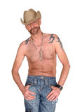 Tattoo, hat wearing man. Attractive, mid fifties bearded, man with tattoo wearing hat.  Jeans dressed. Aging beauty, alternative, diversity person Stock Image