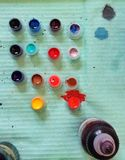 Tattoo ink. Different colors of tattoo ink in a plastic cups prepared for tattoo session Stock Photos