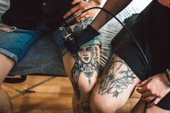 A tattoo on leg. The drawing process. Closeup. The concept of tattoo as art Royalty Free Stock Photography