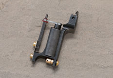 Tattoo machine ( gun ). Rotary professional tattoo machine ( gun stock photo
