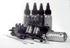 Tattoo machine. A tattoo artist while working in the Studio Royalty Free Stock Images