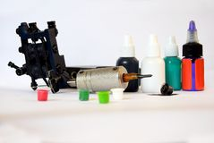 Tattoo machine. A tattoo artist while working in the Studio Royalty Free Stock Photos
