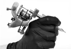 Tattoo machine. A tattoo artist while working in the Studio Stock Photography
