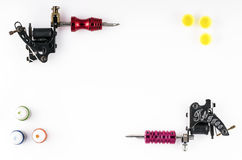 Tattoo machines with three bottles of ink and three ink containers on white background Royalty Free Stock Images