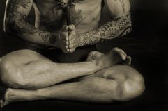 Tattoo man doing yoga Royalty Free Stock Image