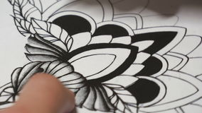 Tattoo master drawing sketch close-up stock footage