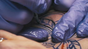 Tattoo master makes the tattoo close-up stock video