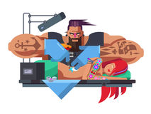 Tattoo master at work Stock Photos