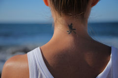 Tattoo on the neck. Tattoo on the back part of neck royalty free stock photos