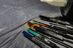 Tattoo needles covered with colorful inks on table, closeup. Space for text royalty free stock photos