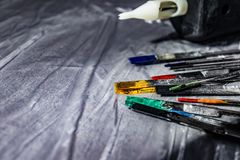 Tattoo needles covered with colorful inks on table, closeup. Space for text stock photography