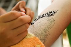 Tattoo painting. At arm royalty free stock images
